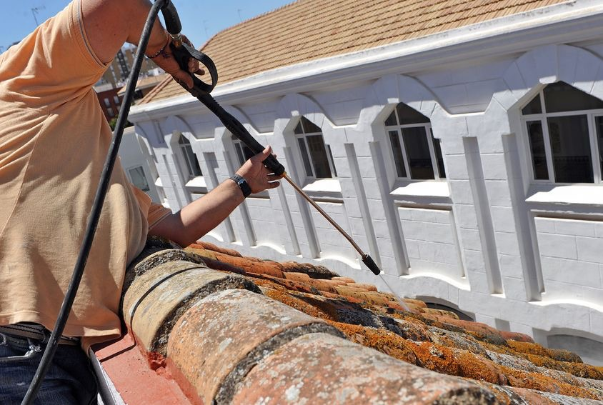 Roofer Maintaining a Roof